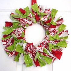 Cut Christmas fabrics with pinking/serrated scissors, tie onto wire wreath.