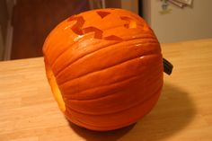 Carve pumpkin from the bottom then simply set over candle.  Martha showed me how to do this years ago.