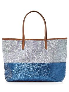 Your niece's boring backpack just got the boot! This roomy tote from Old Navy sparkles with two tones of spangles and faux-leather trim. #GoodHousekeeping #GiftIdeas