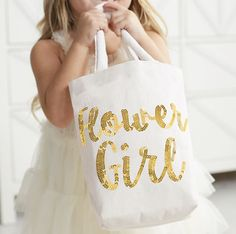 This purse is super sweet and sparkly! This flower girl gift bag will light up her eyes and melt your heart. White jute with Flower Girl written in gold sequins. Inside you'll find a little pocket as