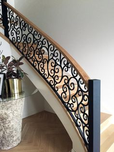 Wrought Iron Stair Case railing custom made by Adoore Iron Design located in Melbourne.