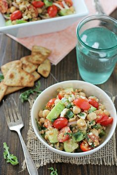 "Greek farro salad. A greek salad inspired ""pasta salad"" that uses the whole grain farro in place of the pasta."