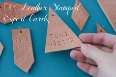DIY Leather Stamped Escort Cards via One Lovely Day