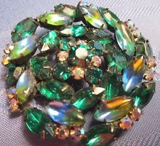 VINTAGE LARGE ROUND BROOCH WITH BLUE, GREEN RHINESTONES & CLEAR AURORA BOREALIS