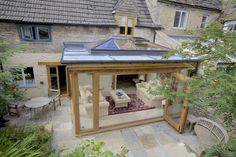 A beautiful flat roof traditional orangery with a glass lantern and bi-folding doors, providing much needed light into a dark home. House With Porch, House Roof, Simple Porch Designs, Porch Kits, Pergola With Roof, Pergola Plans, Diy Pergola, Pergola Kits, Pergola Ideas