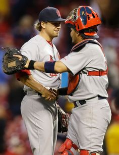 relief pitcher Trevor Rosenthal is congratulated by catcher Yadier Molina after they defeated the Cincinnati Reds 7-6. 4-03-14