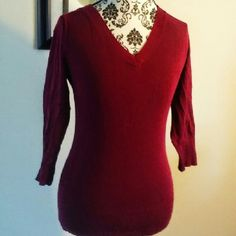 Burgundy Top Pre owned in good condition features V neckline & quater sleeves. Very light wear. Material is 78% rayon and 22% nylon. attention Tops Tees - Short Sleeve
