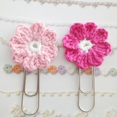 A crochet pattern of a flower that can be used with a giant paperclip as a cute bookmark.