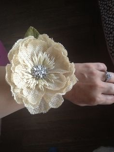 Burlap flower corsages for our wedding.