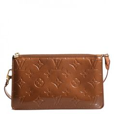 This is an authentic LOUIS VUITTON Vernis Lexington Pochette Bronze. This chic pochette is crafted of Louis Vuitton monogrammed embossed vernis patent leather.