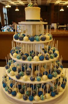 Peacock Colors Wedding Cake Pop Tower... i think i  like this. ... very easy for the guests and me. esp with my messy self and a white dress... lol - so much cuter than a cake!