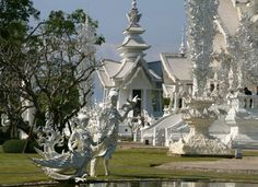 Statues at pond, White Temple