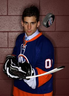 John Tavares John Tavares poses for a portrait after being picked number one overall in the 2009 NHL Entry Draft by the New York Islander at the Bell Centre on June 26, 2009 in Montreal, Quebec, Canada.