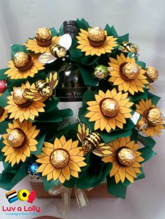 Chocolate sunflower bouquet using Ferrero sunflowers and includes a wine bottle
