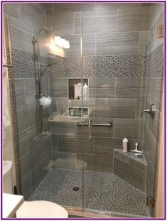 x tile on the shower walls with a glass and stone mosaic used on the shower floor and border. The frameless glass shower enclosure, x tile on the shower walls with a glass and stone mosaic used on the shower floor and border. The frameless glass shower.