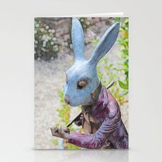 A handmade greetings card that is an illustration of the White Rabbit in Alice in Wonderland, a digital painting from a photograph of a sculpture that I