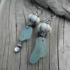 """Earrings Everyday: sea glass with ceramic by Cindy Pack of Art and Soul: """"These earrings feature ceramic beads from my latest kiln batch. White stoneware clay with variegated color glazes. Hints of deep blue, and golden brown with a white matte over-coat and background. Highlighted by the texture."""""""