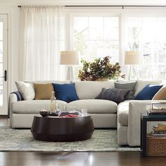 There's a reason it's called Lounge. This 3-piece sectional sofa, made up of a right arm sofa, a corner and a left arm sofa, features super-deep, low seats and super-soft back cushions that invite family to pile on and sink in.