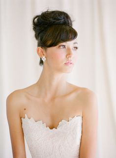 Bun with bangs #hairstyles View entire slideshow: 15 Best Bridal Buns on http://www.stylemepretty.com/collection/539/ | Photography: KT Merry Photography - ktmerry.com