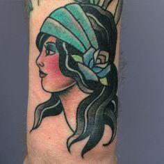 Traditional gypsy girl head tattoo. @zanependergast