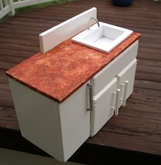 How to build sink and cabinet.  Note the handles and the door opener.