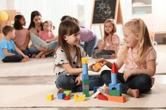 Cute girls playing with building blocks on floor while kindergarten teacher reading book to other children indoors - Buy this stock photo and explore similar images at Adobe Stock Kindergarten Teachers, Children Photography, Cute Girls, Books To Read, Indoor, Flooring, Stock Photos, Play, Reading