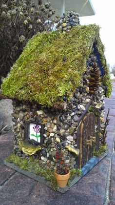 Fairy house handcrafted with forest materials found in Michigan woods, glue onto milk cartons for camp