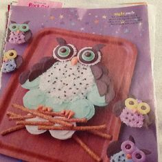 Owl cup cakes middle feathers use coconut.  Edge of cupcakes chocolate sprinkles. Wings-Cookies - chocolate vanilla wafers cut in half.    Mini chocolate chips for black dots. Eyes - jelly rings  center of eyes junior mint or m& m. Orange are circus peanuts