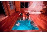 On my list of Places I'd Like To Visit: Over-water bungalow glass floor - Casa Ventanas. Cayo Espanto Private Island, Belize