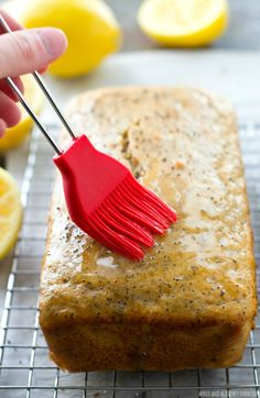 Supremely-moist inside and loaded with lemon and poppyseeds, this stunning quick bread is a perfect springtime treat. The sweet lemon-y glaze on the outside is unbelievable! Just Desserts, Delicious Desserts, Dessert Recipes, Yummy Food, Lemon Recipes, Sweet Recipes, Baking Recipes, Dessert Bread, Yogurt