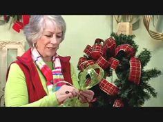 NANCY ADDS TWO RIBBONS TO A WREATH: Nancy of www.LadybugWreath... shows you how to make a beautiful, inexpensive wreath with a gorgeous full bow with 2 ribbons! Nancy makes a large beautiful bow right in front of you using her tips she developed when she taught bow and wreath-making classes when she owned her hometown business.