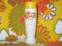 "Tame ""Cream Rinse"" before we had ""conditioner.""  I remember an even older bottle than this. Green logo."