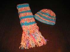 Colorful and fun to wear scarf and hat for little girls.