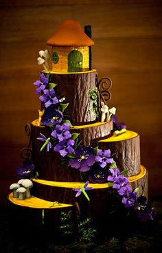 Enchanted Woods - To bring the outdoor ceremony inside for their reception, we made this couple's cake an edible woodland fantasy. Combining hand-painted wood with textured fondant bark made the base of the cake rustic, but still delicious. Then, we added gum paste flowers, fondant mushrooms, and all sorts of woodland critters for guests to discover as they explored the cake. Photo Credit: Graddy Photography