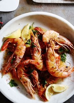 """Gambas al Ajillo   A popular tapa in Spain, gambas al ajillo means """"garlic shrimp,"""" and this version lives up to its name. Three garlic cloves infuse the cooking oil, and then three sliced cloves are sautéed along with the shrimp. Red pepper flakes add a spicy kick."""