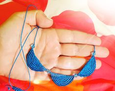 Blue micromacrame necklace half-circles with blue translucent beads adjustable length