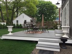 Beautiful x deck - above ground with steps from the side and from the back. Island Mist Trex decking and white pvc trim for fascia. Small Backyard Decks, Decks And Porches, Backyard Patio, Low Deck Designs, Indoor Outdoor Fireplaces, Deck Steps, Backyard Makeover, Building A Deck, Outdoor Landscaping