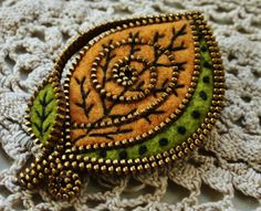 Abstract felt and zipper  leaf brooch by woollyfabulous on Etsy