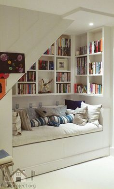 Corner in living room with built in seating, storage and bookshelves...also double as an optional sleep zone for company