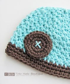kid's beanie with crocheted button..georgia- the button would work well for the boys hats!