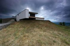 Modern hill home design architectural with landscape wall ideas