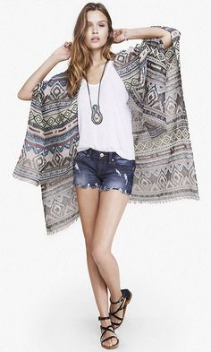 A lightweight Aztec print shawl guaranteed to take your fit to the next level