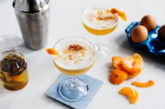 """Spiced Clementine Sour - Clementine juice and spiced syrup add the perfect winter touch to this classic whiskey sour that embodies hygge, the Danish term for """"cozy. Sour Cocktail, Cocktail Recipes, Rye Cocktails, Cocktail Club, Winter Cocktails, Craft Cocktails, Drink Recipes, Clementine Juice, Whiskey Sour"""