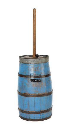 "Painted butter churn, 19th c., retaining an old blue surface, 40"" h."
