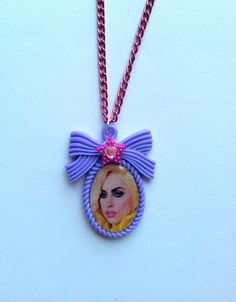 Lady GaGa Necklace on a purple bow cameo, pink metal chain, pink star and heart crystal. Poker face, Paparazzi, bad romance, just dance by AngelicConcepts, $14.00