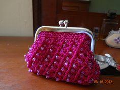 Para los cambios que tal en un monedero que no pasa de moda además tejido a crochet