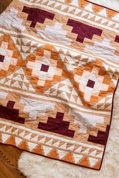 Make a Desert Valley Inspired Mayan Mosaic Quilt - Suzy Quilts - - Be inspired by colors of the desert and make your own Mayan Mosaic quilt. With warm solid hues, this quilt design looks modern and timeless. Southwestern Quilts, History Of Quilting, Quilt Modernen, Geometric Quilt, Modern Quilt Patterns, Patchwork Patterns, Modern Quilting Designs, Quilt Designs, Quilting Patterns