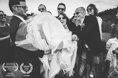 Award-winning wedding picture - Wedaward AND Wedisson - bride being lift by wedding party - Zephyr & Luna photograhy
