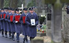Poland and the RAF buried the last Polish airman to fly in the Battle of Britain with full military honours in Warsaw after his ashes had received a hero's welcome in his native land.
