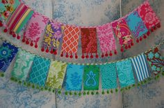 what's not to love? beautiful bright fabric bunting with pom poms!